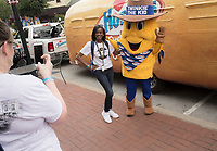 NWA Democrat-Gazette/CHARLIE KAIJO Beth Hyde of Charlotte, NC takes a picture of Tasara Coston of Bentonville (center) as she poses with Twinkie The Kid, Monday, June 3, 2019 at the downtown square in Bentonville<br />