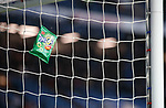 16.02.2020 Rangers v Livingston: The high winds from Storm Dennis pin a 39p bag of cheese and onion Ringos against the goal net at Ibrox
