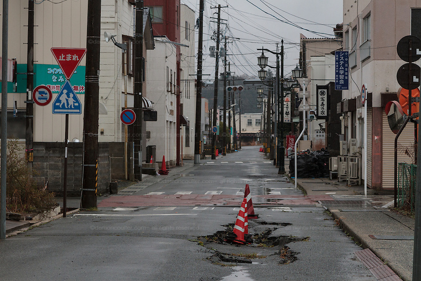 Earthquake damaged buildings and roads inside the Fukushima exclusion zone, Namie, Fukushima, Japan. Wednesday March 9th 2016. The Great East Japan Earthquake on March 11th 2011 was followed by a massive tsunami that levelled much of the Tohoku coast in north east Japan, killing around 18,000 people and causing meltdowns and explosions at the Fukushima Daiichi nuclear power station leading to the contamination and evacuation of a 20 kilometre exclusion zone around the plant.