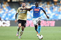 Andrea Petagna of SPAL and Kalidou Koulibaly of Napoli compete for the ball during the Serie A football match between SSC  Napoli and SPAL at stadio San Paolo in Naples ( Italy ), June 28th, 2020. Play resumes behind closed doors following the outbreak of the coronavirus disease. <br /> Photo Cesare Purini / Insidefoto