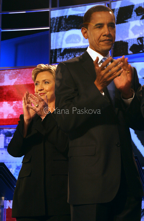 Democratic presidential candidates (L-R) Sen. Hillary Clinton (D-NY), and Sen. Barack Obama (D-IL) wave to the audience from the stage before their debate at St. Anselm College on June 3, 2007, in Manchester, New Hampshire. The debate's sponsors include CNN, Hearst Argyle's WMUR-TV and the New Hampshire Union Leader. The Republican candidates' debate is scheduled on June 5, 2007.