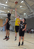 Action from the boys match between Wellington and North Harbour during the National Under-15 Basketball Championship at the ASB Sports Centre, Kilbirnie, Wellington, New Zealand on Thursday, 25 July 2013. Photo: Dave Lintott / lintottphoto.co.nz