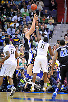 D.J. Cunningham of the Bulldogs pulls up for a jumper over Dante Taylor of the Panthers. Pittsburgh defeated UNC-Asheville 74-51 during the NCAA tournament at the Verizon Center in Washington, D.C. on Thursday, March 17, 2011. Alan P. Santos/DC Sports Box