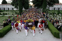 Gubbio 15 MAY 2004..Festival of the Ceri..All the hierarchy of ceraioli go in procession to the local cemetery along with the mayor and other authorities of the town to lay a wreath of flowers in memory of dead ceraioli...http://www.ceri.it/ceri_eng/index.htm..