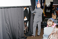 A campaign worker (left) and Secret Service agent readies a screen before Democratic presidential candidate and former First Lady and Secretary of State Hillary Rodham Clinton speaks at the Women's Economic Opportunity Summit at Southern New Hampshire University in Hooksett, New Hampshire.