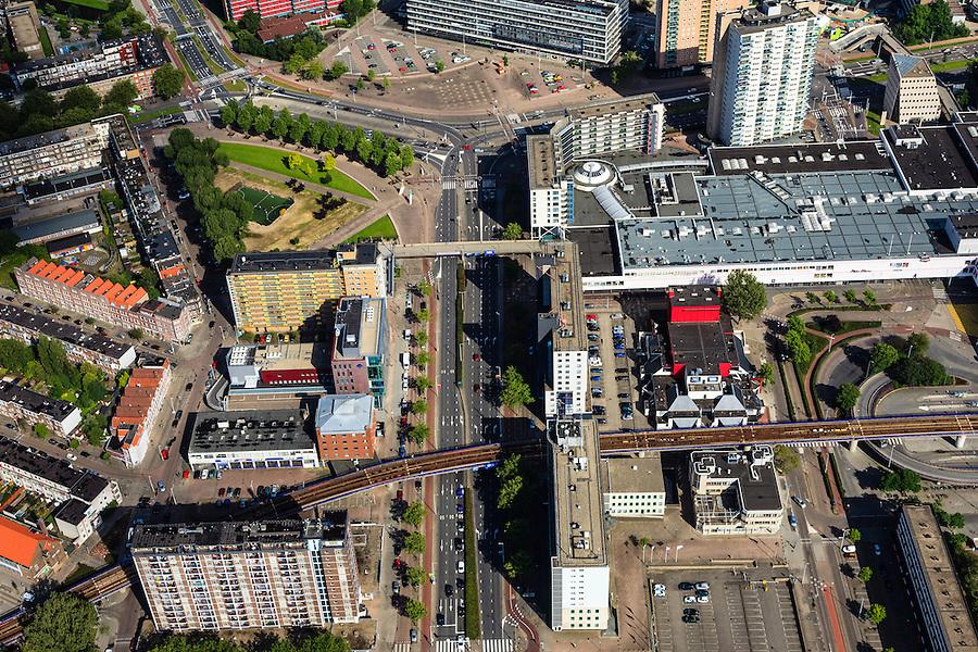Nederland, Zuid-Holland, Rotterdam, 15-07-2012; Rotterdam-Zuid, winkelcentrum Zuidplein. .The south of Rotterdam, shopping mall Zuidplein (right) and underground. .luchtfoto (toeslag), aerial photo (additional fee required).foto/photo Siebe Swart