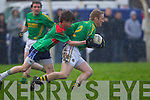 Finuge's Chris Allen tries to free himself from Tom Joy of Beal in the Bernard O'Callaghan Memorial Senior Football Championship Final last Sunday in Ballylongford.