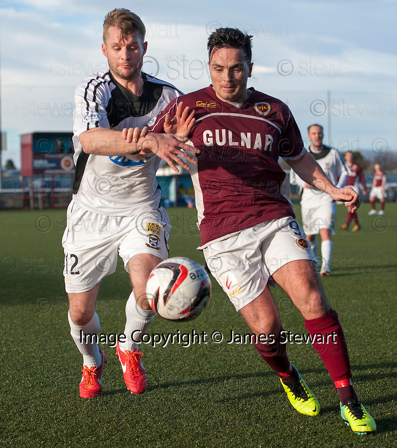 East Fife's Kevin Rutkiewicz and Stenny's Sean Higgins challenge for the ball.<br /> <br /> <br /> 15/02/2014   jspa003_smuir_v_efife     <br /> Copyright  Pic : James Stewart   <br /> <br /> James Stewart Photography 19 Carronlea Drive, Falkirk. FK2 8DN      Vat Reg No. 607 6932 25   Tel:  +44 (0)7721 416997<br /> E-mail  :  jim@jspa.co.uk   If you require further information then contact Jim Stewart on any of the numbers above........