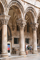 The arched porch of the Rector's Palace Knezev Dvor on the Pred Dvorom street Dubrovnik, old city. Dalmatian Coast, Croatia, Europe.