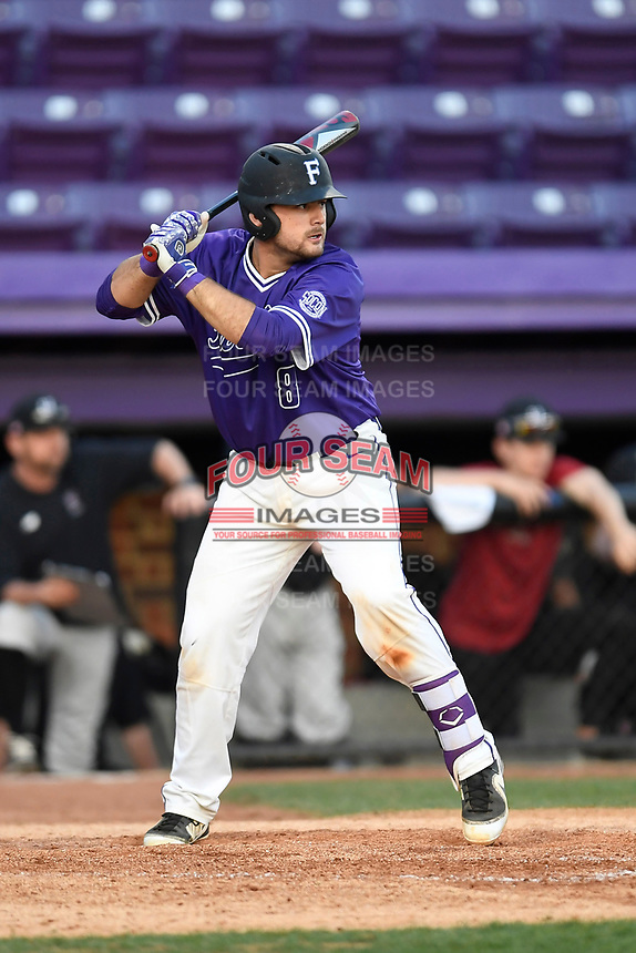 Catcher John Michael Boswell (8) of the Furman Paladins bats in game two of a doubleheader against the Harvard Crimson on Friday, March 16, 2018, at Latham Baseball Stadium on the Furman University campus in Greenville, South Carolina. Furman won, 7-6. (Tom Priddy/Four Seam Images)
