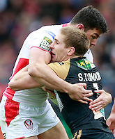 PICTURE BY CHRIS MANGNALL /SWPIX.COM...Rugby League - Super League  - St Helens Saints v Wigan Warriors  - Langtree Park, St Helens, England  - 06/04/12... St Helens Mark Flanagan  tackles  Wigans Sam Tomkins