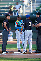 Idaho Falls Chukars manager Omar Ramirez (11) shakes hands with opposing manager Juan Francia (3) during the lineup exchange before a Pioneer League game against the Missoula Osprey at Melaleuca Field on August 20, 2019 in Idaho Falls, Idaho. Idaho Falls defeated Missoula 6-3. (Zachary Lucy/Four Seam Images)