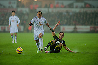 Sunday  14th   December 2014 <br /> Pictured: Jefferson Montero of Swansea City gets the batter of Federico Fazio of Tottenham Hotspur  <br /> Re: Barclays Premier League Swansea City v Tottenham Hotspur  at the Liberty Stadium, Swansea, Wales,UK