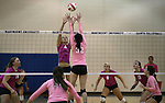 Marymount's Emily Shultis goes up for a block during a college volleyball match against Shenandoah at Marymount University in Arlington, Vir., on Tuesday, Oct. 8, 2013.<br /> Photo by Cathleen Allison