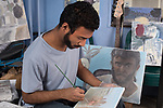 Young man, artist at work in home studio, oil painting, self portrait nearby