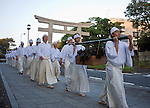 Priests and parishioners carry a crate if seaweed following the hamaorisai rite during the the annual Reitaisai Grand Festival at Tsurugaoka Hachimangu Shrine in Kamakura, Japan on  14 Sept. 2012.  Sept 14 marks the first day of the 3-day Reitaisai festival, which starts early in the morning when shrine priests and officials perform a purification ritual in the ocean during a rite known as hamaorisai and limaxes with a display of yabusame horseback archery. Photographer: Robert Gilhooly