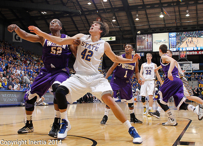 SIOUX FALLS, SD - MARCH 9: Michael Ochereobia #52 of Western Illinois and Jordan Dykstra #42 of South Dakota State battle for rebounding position during their first round game at the 2014 Summit League Basketball Championships Sunday at the Sioux Falls Arena.  (Photo by Dick Carlson/Inertia)