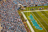 Crowds fill the stands at Bank of America Stadium in Charlotte, NC. Photo from the Carolina Panthers' 20-9 loss to the Buffalo Bills in Charlotte on Sunday, Oct. 25, 2009. Professional American NFL football team The Carolina Panthers represents North Carolina and South Carolina from its hometown of Charlotte, NC. The Carolina Panthers are members of the NFL's National Football Conference South Division. The Charlotte professional football team began playing in Charlotte in 1995 as an expansion team.  The Carolina Panthers play in Bank of America Stadium, formerly known as Carolinas Stadium and Ericsson Stadium.