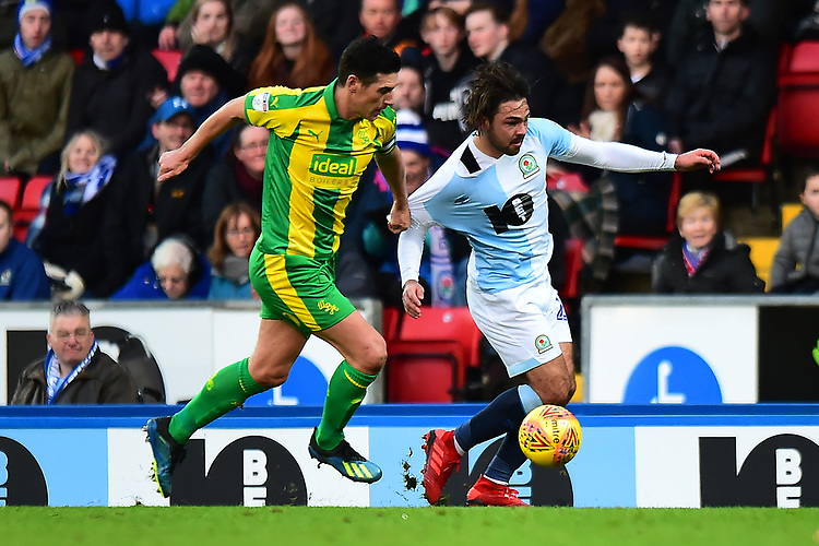 Blackburn Rovers' Bradley Dack is challenged by West Bromwich Albion's Gareth Barry<br /> <br /> Photographer Richard Martin-Roberts/CameraSport<br /> <br /> The EFL Sky Bet Championship - Blackburn Rovers v West Bromwich Albion - Tuesday 1st January 2019 - Ewood Park - Blackburn<br /> <br /> World Copyright © 2019 CameraSport. All rights reserved. 43 Linden Ave. Countesthorpe. Leicester. England. LE8 5PG - Tel: +44 (0) 116 277 4147 - admin@camerasport.com - www.camerasport.com
