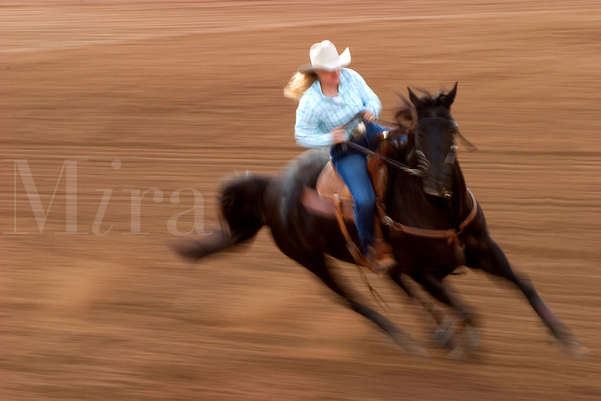 February, 2004 At the Tucson Rodeo, barrel racers (cowgirls) in the competition in Tucson, Arizona.. .For Editorial use only / Permission from Pro Rodeo Cowboy's Association REQUIRED for any commercial usage..