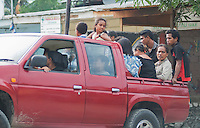 Pickup truck loaded with passengers, Dili, Timor-Leste (East Timor)