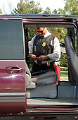 Kensington, MD - October 3, 2002 -- Unidentified Montgomery County Police Officer investigates the van at the Shell Station in Kensington, MD where 25-year-old Lori Ann Lewis-Rivera was ambushed and killed while vacuuming out her vehicle this morning, 3 October, 2002 in Kensington, MD.<br /> Credit Ron Sachs / CNP<br /> <br /> (RESTRICTION: NO New York or New Jersey Newspapers or newspapers within a 75 mile radius of New York City)