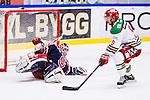 S&ouml;dert&auml;lje 2013-12-12 Ishockey Hockeyallsvenskan S&ouml;dert&auml;lje SK - Mora IK :  <br /> S&ouml;dert&auml;lje m&aring;lvakt 43 Sebastian Idoff  r&auml;ddar ett avslut av Mora 9 Mikael Zettergren <br /> (Foto: Kenta J&ouml;nsson) Nyckelord: