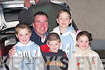 FRIENDS: The Crowe family and friend, Declan, Keelan, Caitlin and Nigel Crowe and Oisin Coen enjoying the Samhlaiocht Easter Parade on Saturday night in Tralee..