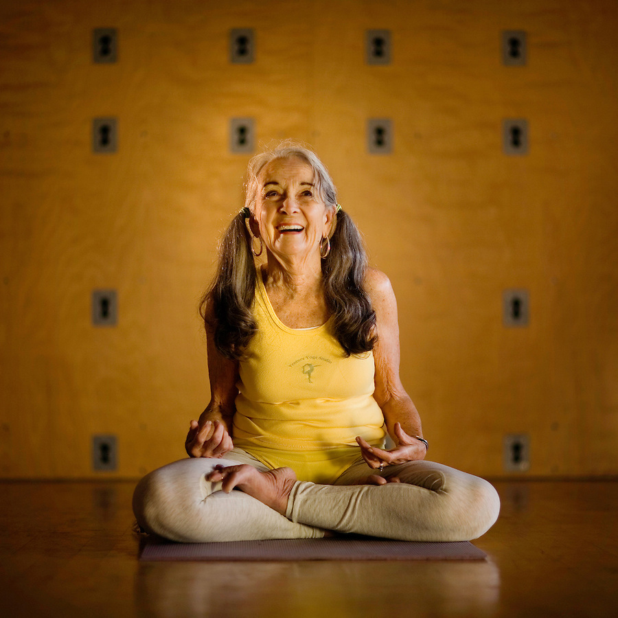 "Bev Graves, 83, of Ventura, before her class in Iyengar yoga at the Ventura Yoga Studio, Ventura, Calif., Monday, Dec. 11, 2006. Graves, who was diagnosed with scoliosis in her early 50's, began yoga as a means to help her deal with this debilitating condition. She has studied with Mr. Iyengar 10 times at his retreat in Pune, India and continues by practicing daily and teaching three to four days a week. ""I just love yoga,"" says Graves, ""It breathes life into every inch of your body."" ."