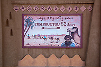 "Zagora, Morocco.  ""Timbuktu 52 Days"" Sign Alluding to the Time Needed to Reach Timbuktu by Camel Caravan."