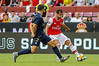 Landover, MD - July 23, 2019: Arsenal Henrikh Mkhitaryan (7) passes the ball during the match between Arsenal and Real Madrid at FedEx Field in Landover, MD.   (Photo by Elliott Brown/Media Images International)