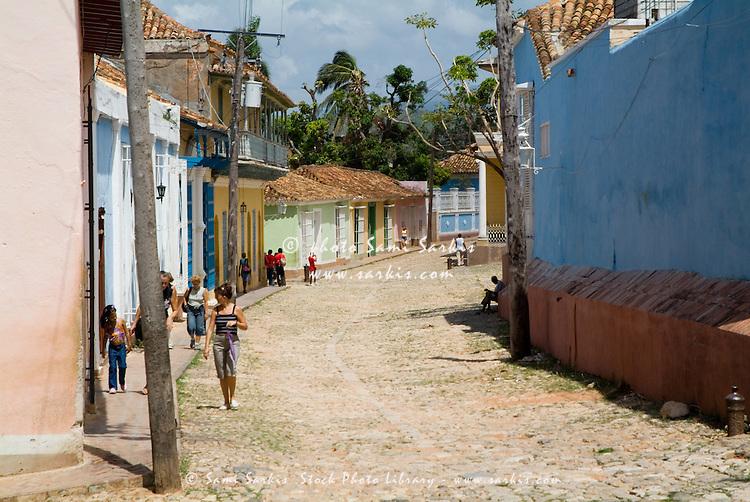 People walking on a cobblestone street, Trinidad, Cuba.
