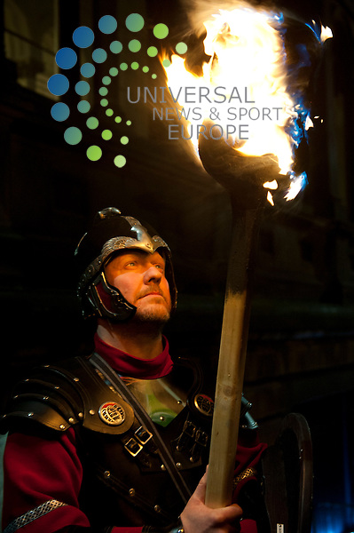 The procession of flaming torches, led by the massed pipes and drums and the Up Helly Aa' Vikings from Shetland, winds through the city streets and up to the national monument on Calton Hill where the event climaxes with the ighting of the effigy on the bonfire and spectacular Son et Lumière and fireworks finale..Picture: Pavol Mraz/Universal News And Sport (Scotland). 30/ December 2012.