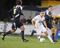 Michael Nanchoff #9 of the University of Akron moves towards Adam Shaw #5 of the University of Michigan during the 2010 College Cup semi-final at Harder Stadium, on December 10 2010, in Santa Barbara, California. Akron won 2-1.