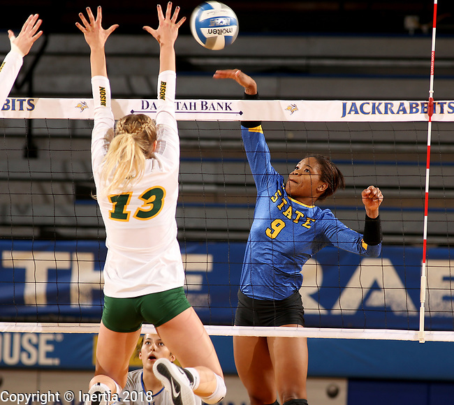 BROOKINGS, SD - OCTOBER 28: Crystal Burk #9 from South Dakota State looks to get a kill past Alexis Bachmeier #13 from North Dakota State during their match Sunday afternoon at Frost Arena in Brookings. (Photo by Dave Eggen/Inertia)