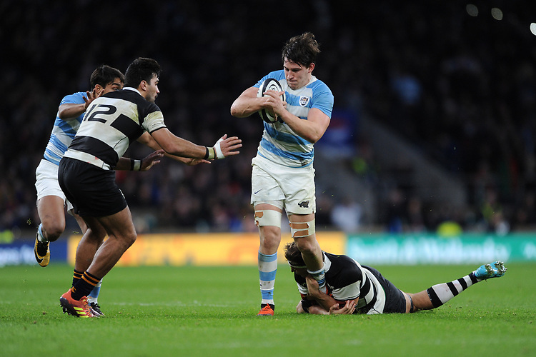 Tomas Lezana of Argentina is tackled by Luke Jones of Barbarians (Bordeaux Begles & Australia)    during the Killik Cup match between the Barbarians and Argentina at Twickenham Stadium on Saturday 1st December 2018 (Photo by Rob Munro/Stewart Communications)