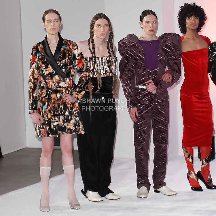 Models pose in outfits from the Vasilis Loizides Fall Winter 2019 collection on February 4, 2019; at 55 Water Street for New York Men's Day Fall Winter 2019, during New York Fashion Week: Men's Fall Winter 2019.