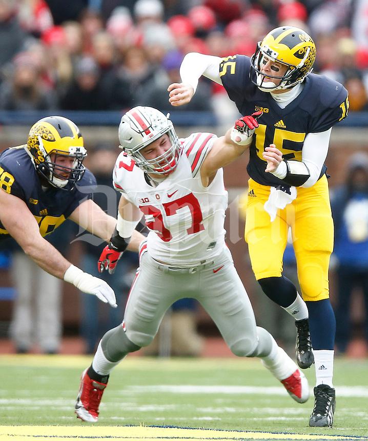 Ohio State Buckeyes defensive lineman Joey Bosa (97) pressures Michigan Wolverines quarterback Jake Rudock (15) at Michigan Stadium on November 28, 2015. (Chris Russell/Dispatch Photo)