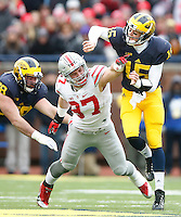 Ohio State Buckeyes defensive lineman Joey Bosa (97) pressures Michigan Wolverines quarterback Jake Rudock (15) at Michigan Stadium on November 28, 2015. (Chris Russell/Dispatch Photo)