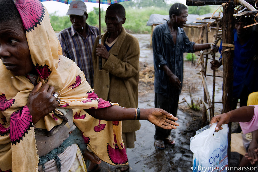 The risk of Malaria is high in Mozambique. Volunteers from the Red Cross give out Mosquito nets to battle the epidemic. The floods have affected most of the volunteers.