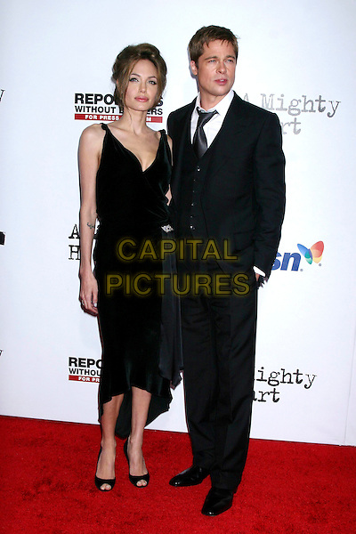 "ANGELINA JOLIE & BRAD PITT.At the premiere of "" A Mighty Heart"" at the Ziefield Theatre, New York, NY, USA..June 13th, 2007.full length black dress suit waistcoat couple peeptoe shoes peep toe brooch sash .CAP/IW.©Ian Wilson/Capital Pictures"