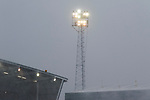The Boundary Park floodlights fail to make much impression on the snow. Oldham v Portsmouth League 1