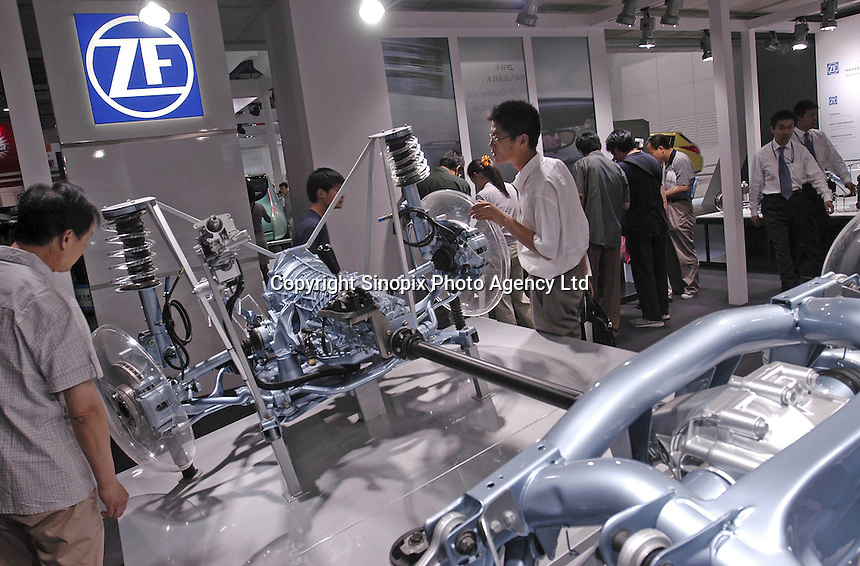 Visitors look at a structural car of ZF Frierichshafeng AG from Germany at the Auto China 2004 exhibition in Beijing, China..