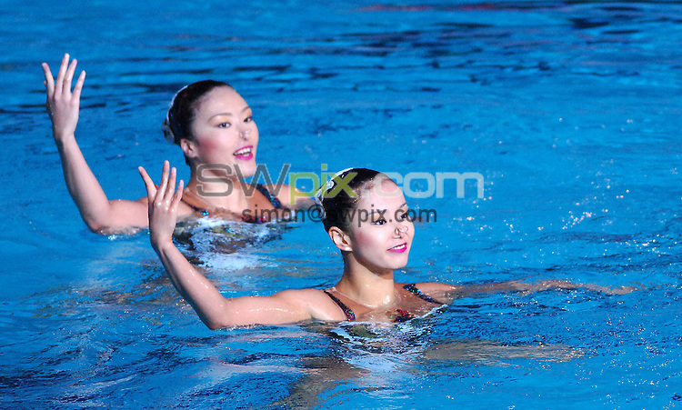 PICTURE BY VAUGHN RIDLEY/SWPIX.COM - Synchronized Swimming - 12th FINA World Championships - Rod Laver Arena, Melbourne, Australia -  17/03/07...Copyright - Simon Wilkinson - 07811 267706...Japan's Saho Harada and Emiko Suzuki compete in the Duet Technical Prelims.