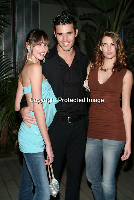 L.A. Models Kira, Jay &amp; Veronica Taylor<br />LA Models / Exclusive Artists Management and LA<br />Talent are holding their annual holiday bash<br />White Lotus<br />Hollywood, CA, USA<br />Tuesday, December 16, 2003 <br />Photo By Celebrityvibe.com/Photovibe.com