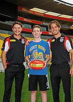 AFLNZ High Performance selection Lewis Gill (centre) with St Kilda AFL players Josh Saunders (centre left) and Jack Steven (right) at the AFL celebration of 100 day countdown until the ANZAC Centenary at Westpac Stadium, Wellington, New Zealand on Wednesday, 15 January 2015. Photo: Dave Lintott / lintottphoto.co.nz