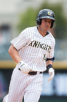 Chris Marrero (14) of the Charlotte Knights rounds the bases after hitting a home run against the Gwinnett Braves at BB&T BallPark on July 3, 2015 in Charlotte, North Carolina.  The Braves defeated the Knights 11-4 in game one of a day-night double header.  (Brian Westerholt/Four Seam Images)