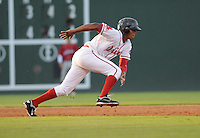 Outfielder Henry Ramos (25) of the Greenville Drive dives back to second base to avoid a pickoff in a game against the Lakewood BlueClaws on July 12, 2011, at Fluor Field at the West End in Greenville, South Carolina. (Tom Priddy/Four Seam Images)