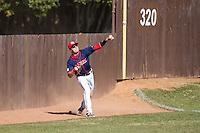 Shippensburg Raiders left fielder Grant Hoover (18) throws the ball back to the infield during the game against the Belmont Abbey Crusaders at Abbey Yard on February 8, 2015 in Belmont, North Carolina.  The Raiders defeated the Crusaders 14-0.  (Brian Westerholt/Four Seam Images)