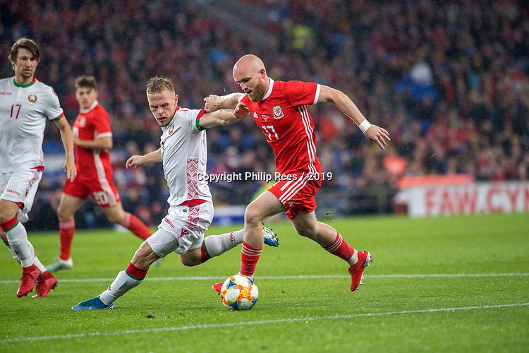 Cardiff - UK - 6th September :<br />Wales v Belarus Friendly match at Cardiff City Stadium.<br />Jonny Williams of Wales holds off Nikolai Zolotov of Belarus in the first half.<br />Editorial use only